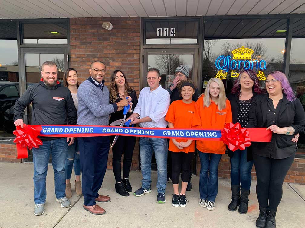 ribbon cutting ceremony for dawg house bar & grill
