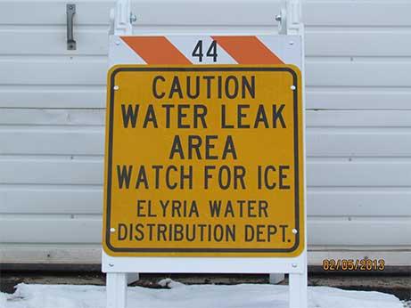 caution water leak sign